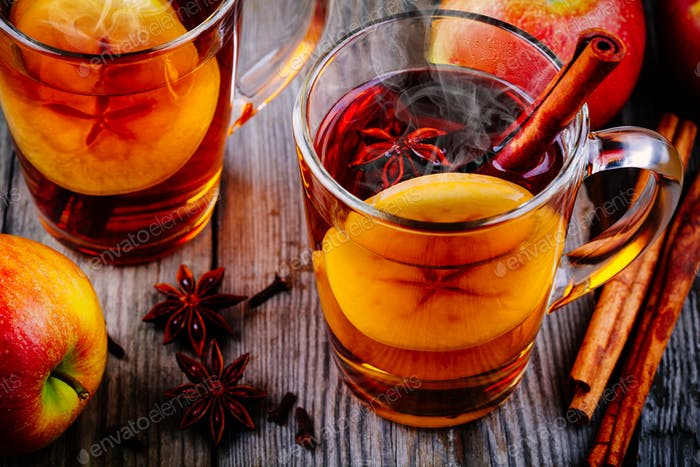homemade hot mulled apple cider with a cinnamon stick