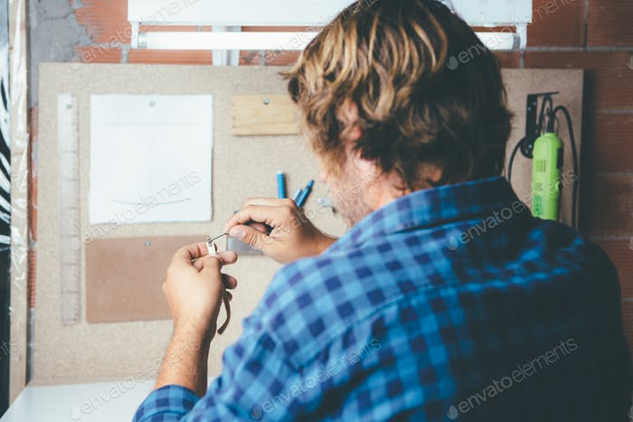 Handworker making glasses rim