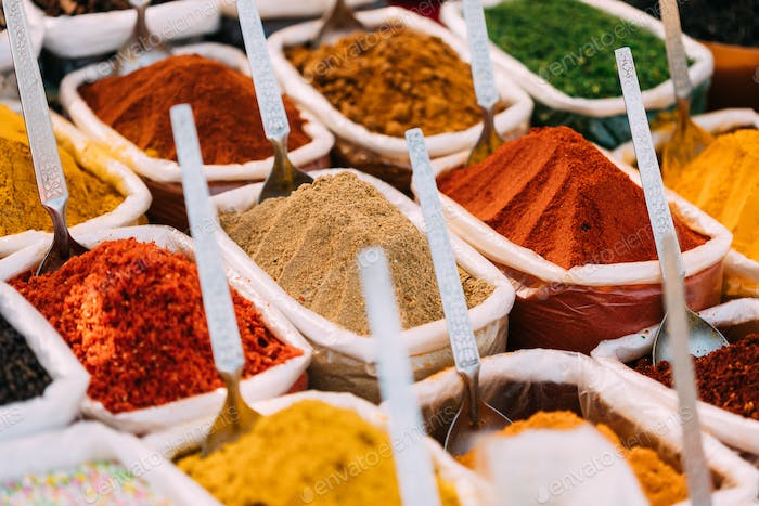 Close View Of Masala Curry, Bright Colors Fragrant Seasoning, Condiment In Bags On Local Food Market