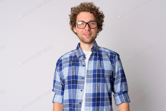Portrait of happy handsome hipster man with eyeglasses smiling