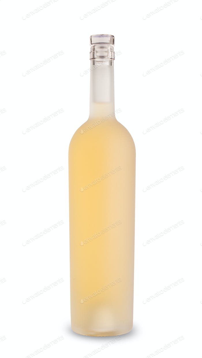 white wine in etched bottle without label