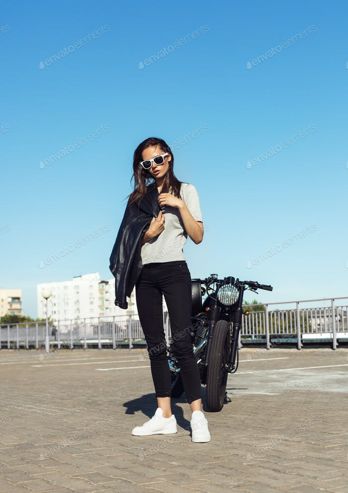 Sexy young woman  with old fashioned motorcycle