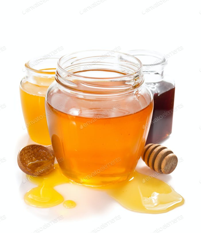 variety of honey in jar white background