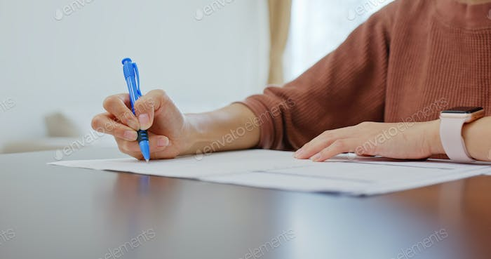 Woman study at home and write on paper