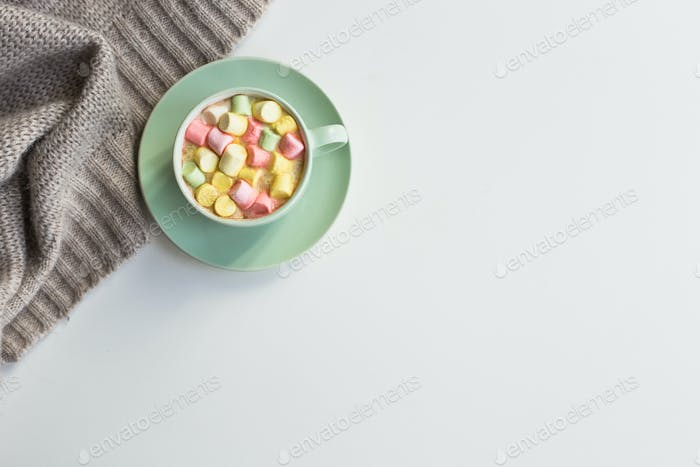 Cup of cocoa with marchmallows on white background