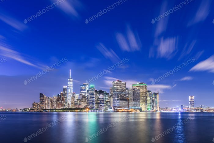 New York, New York, USA skyline on the bay at twilight.