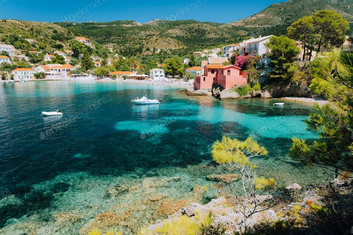 Assos village, Kefalonia Greece. View to cute bay with vivid colored houses and transparent