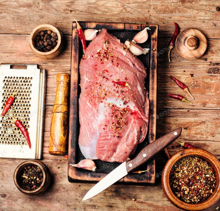 Raw meat with spices