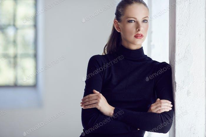 Brunette female in black costume.