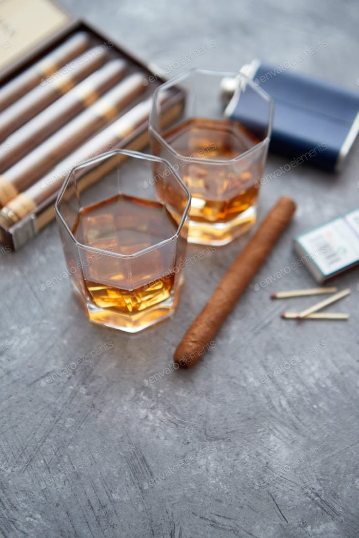 Carafe of Whiskey or brandy, glasses and box of finnest Cuban cigars