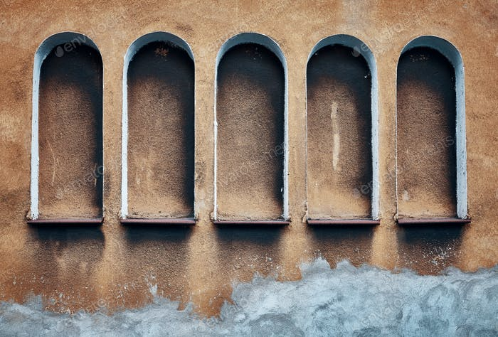Five arched niches in an old wall