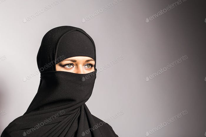 Young arabian woman in hijab or niqab.