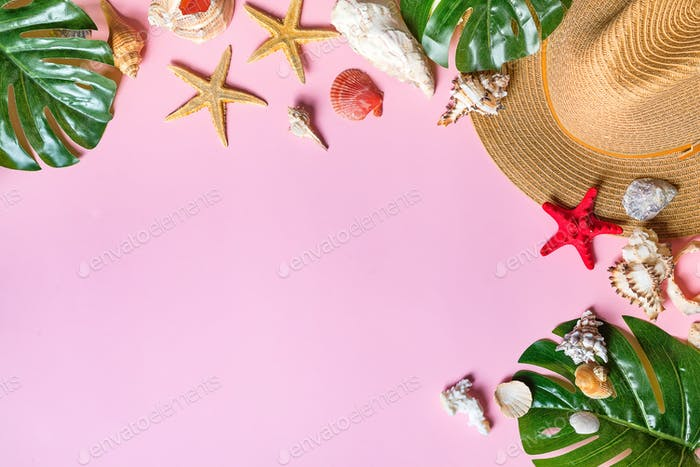 Vacation travel equipment Straw hat, palm leaves and marine objects, shells, starfish On a pink