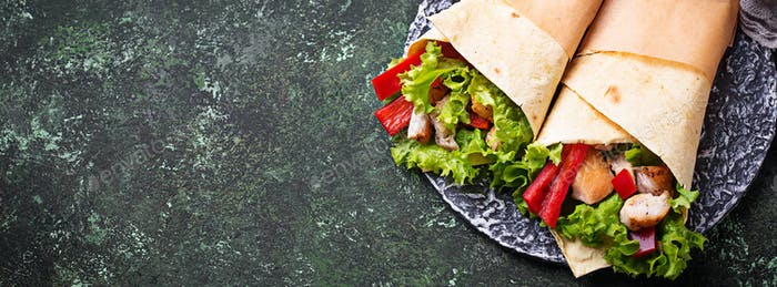Tortilla wraps with  chicken fillet and vegetables