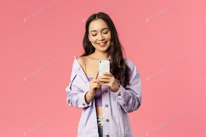 Online lifestyle, people and beauty concept. Portrait of stylish young modern girl blogger taking