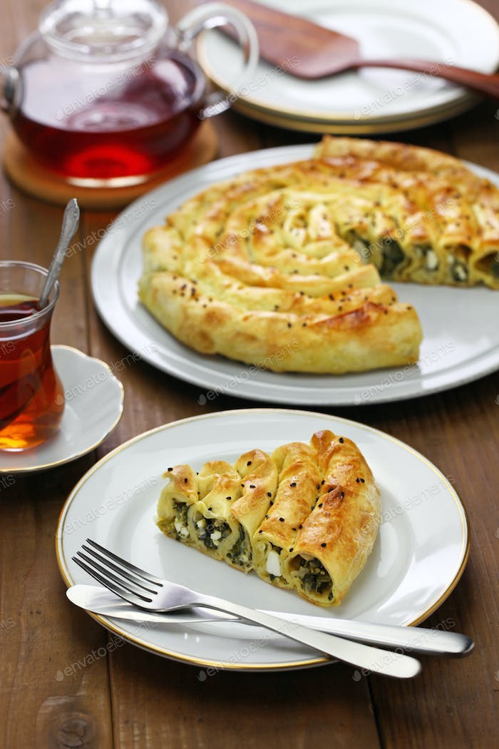 homemade kol borek, turkish rounded pie, spinach and feta cheese