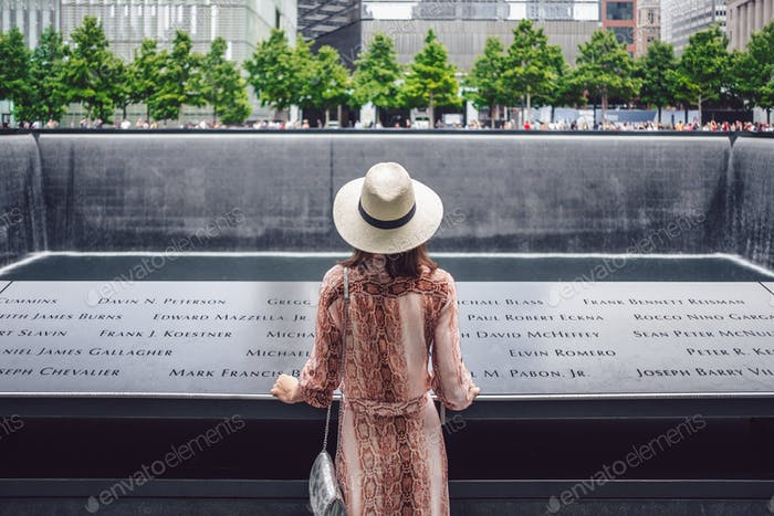 Young tourist at the 9/11 Memorial in New York