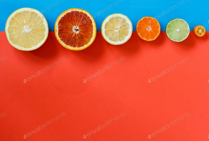 Citrus fruits on a red, and blue background