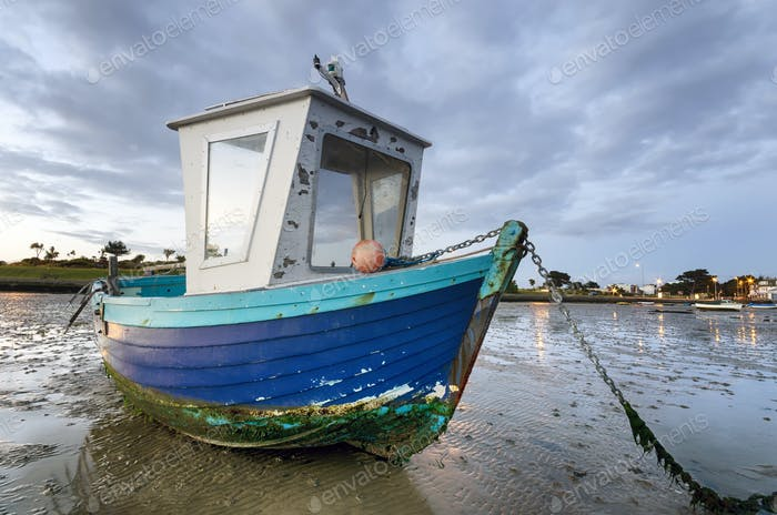 Blue Fishing Boat at Dawn