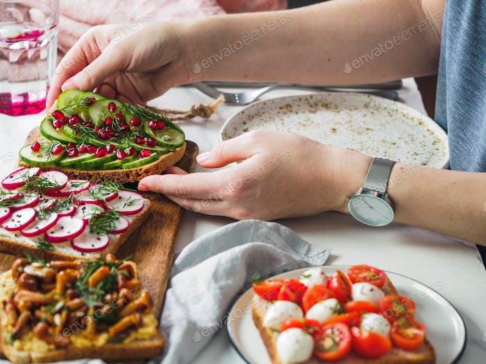 Female hands on vegetarian tablesettings