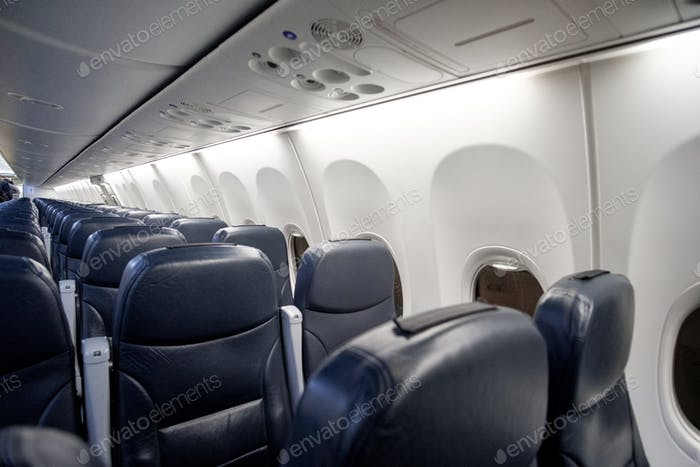 Empty passenger airplane seats in the cabin of plane