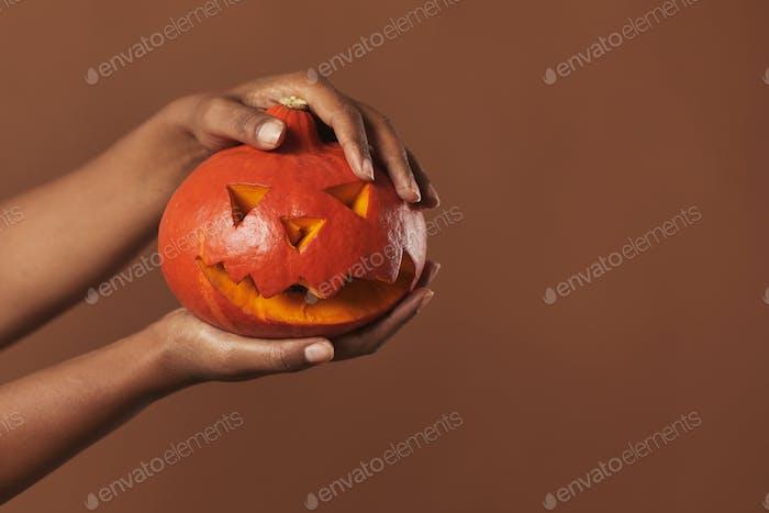 Hands Holding Jack O' Lantern