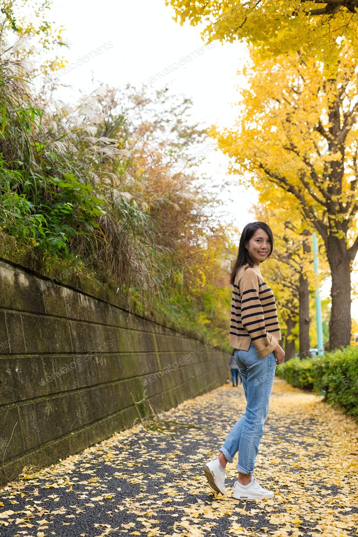 Woman with yellow Gingko tree