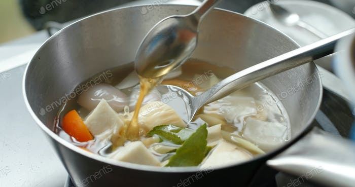 Cooking tom yum soup in kitchen