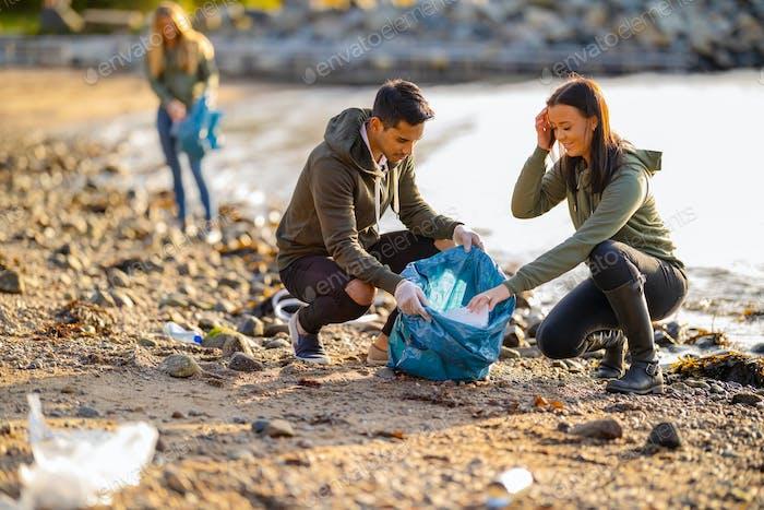 Team of volunteers collecting garbage at beach
