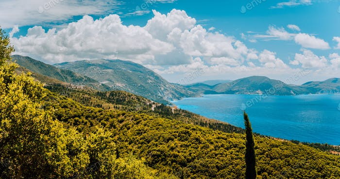 Dramatic cloudscape over Kefalonia west coastline. Greece. Picturesque shoreline of mediterranean