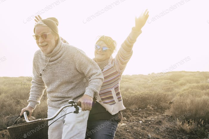 Happiness and freedom concept no limit age with old aged couple laughing smiling and having fun
