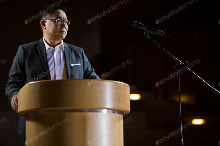 Business executive giving a speech