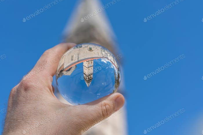 Saint Nikola Church tower reflected in a glass ball