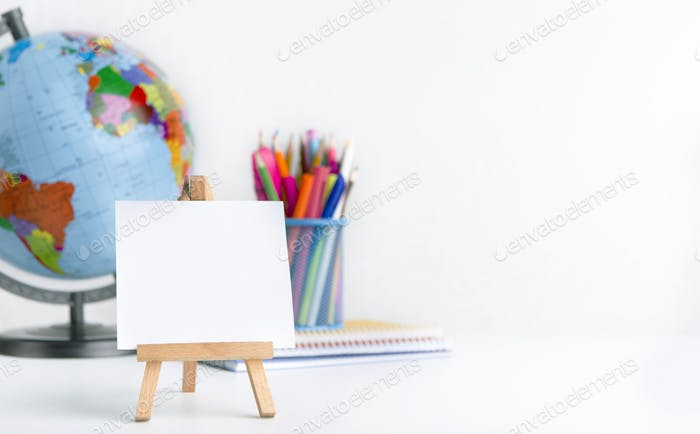Easel with blank space and world globe on white background
