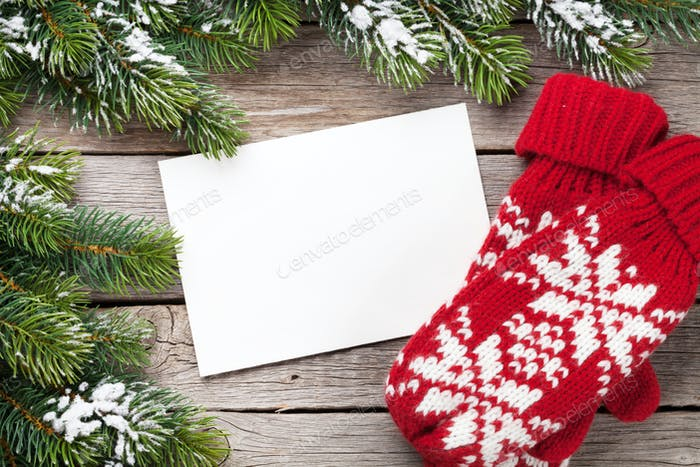 Christmas greeting card, fir tree and mittens