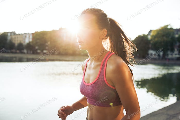 Determined young woman out for a run