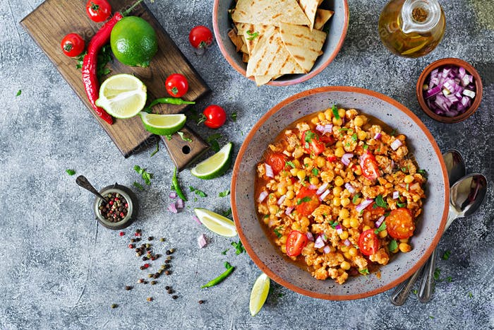 Chili con carne of turkey  with chickpeas served with nachos