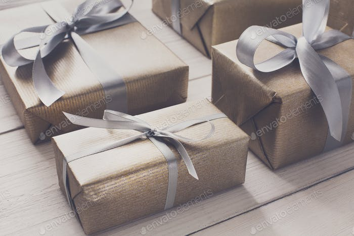 Gift wrapping. Modern christmas present in boxes