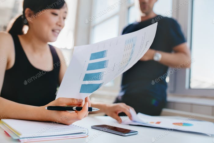 Woman doing financial analysis at office