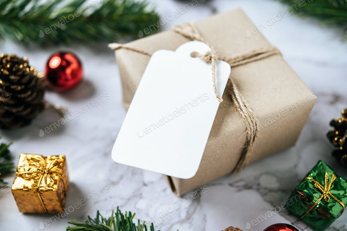 Gift boxes with small gifts on white cement