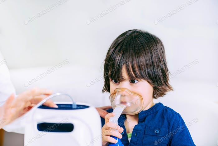Boy using respiratonic inhaler