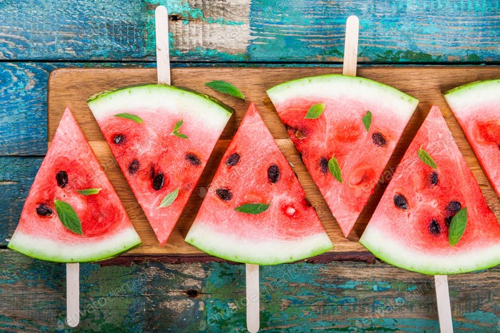 Slices of fresh juicy watermelon on a cutting board closeup