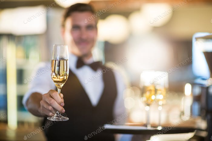 Waiter offering a glass of champagne
