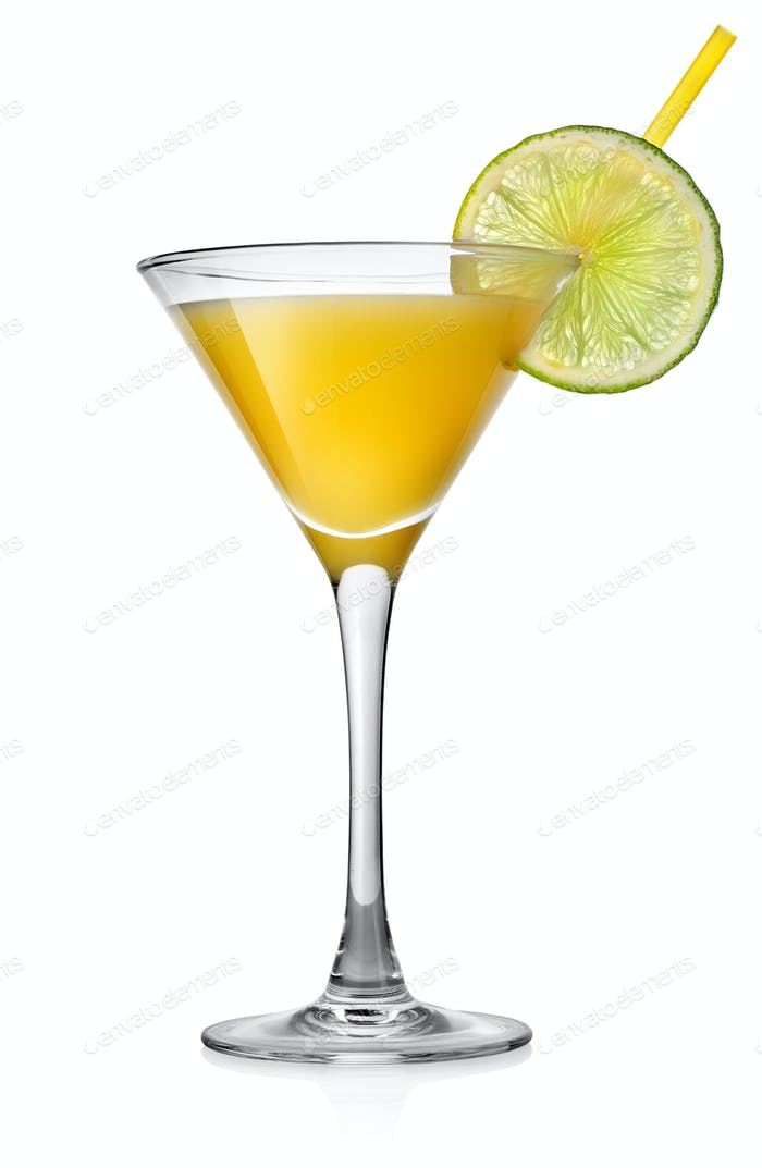 Yellow cocktail with lime