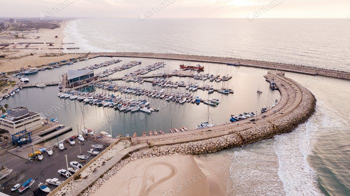 aerial view of harbour with lot of yachts on sunset, Ashdod, Israel