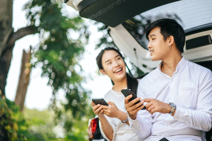 women and men sitting on mobile phones