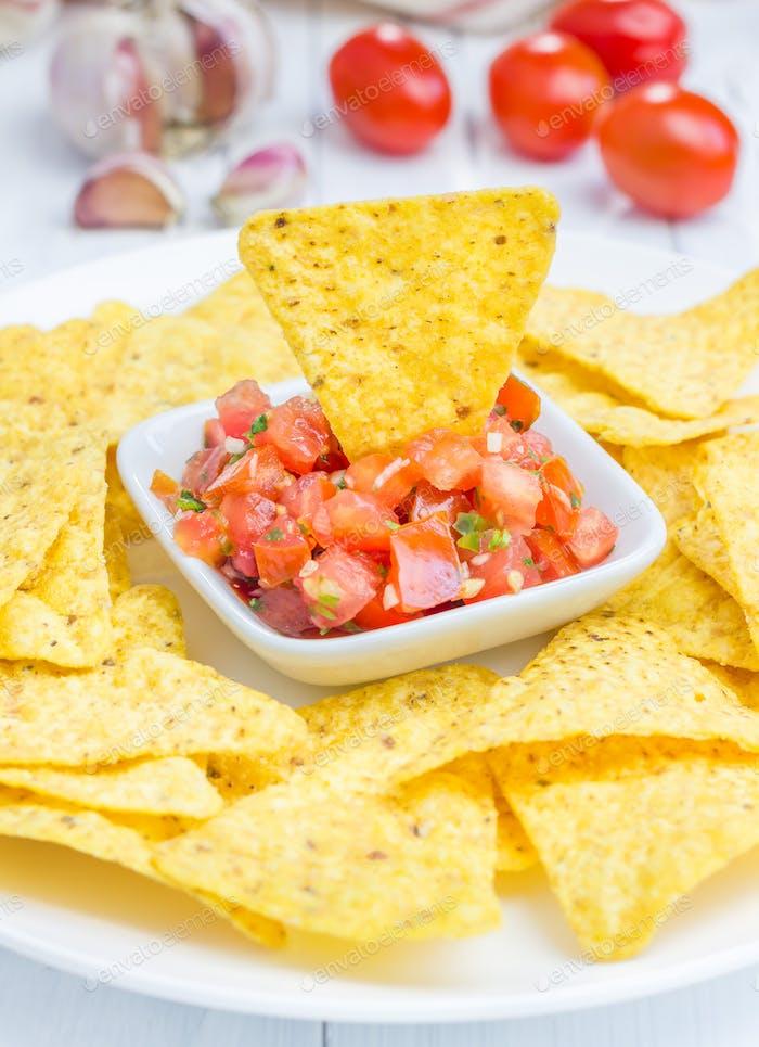 Fresh homemade salsa with nachos