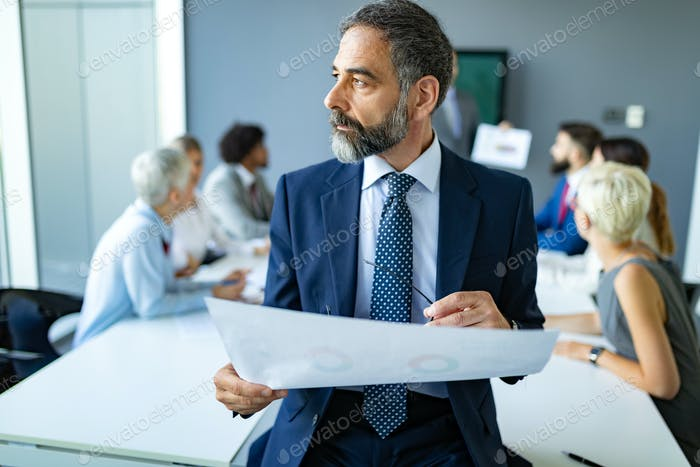 Business colleagues working in modern conference room