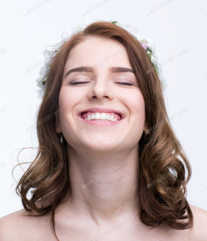 Portrait of a smiling woman with closed eyes