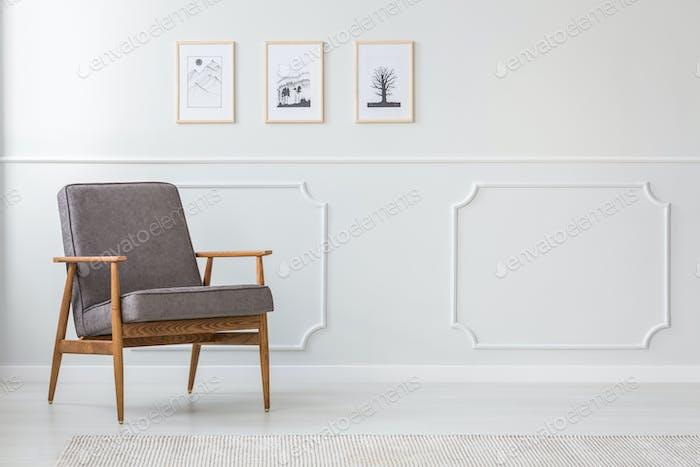 Grey wooden armchair in interior